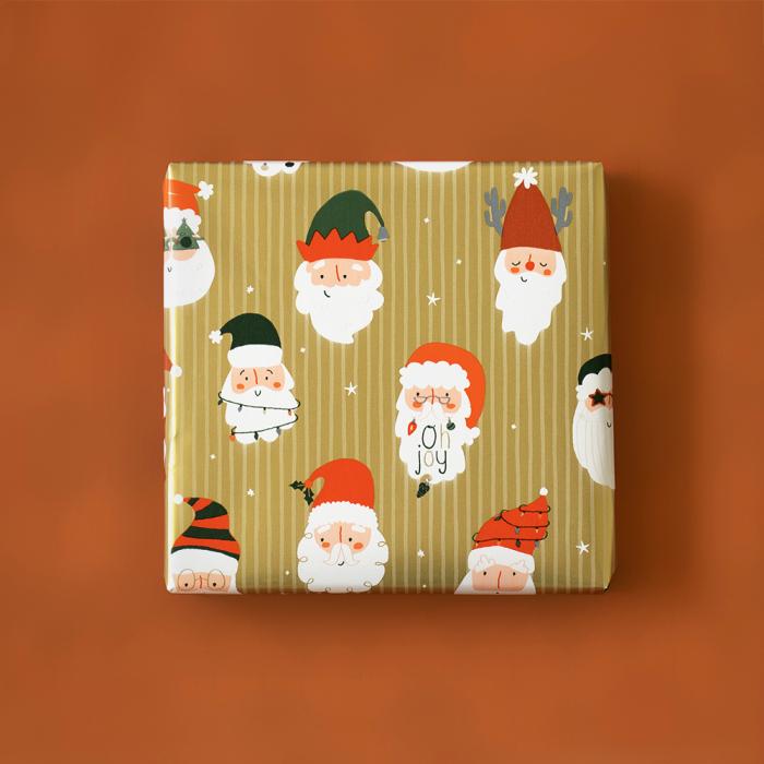 Cadeaupapier goud met kerstmannen (HOP)